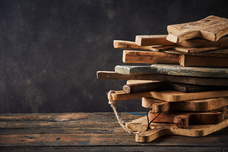 Wooden cutting boards arranged in stack against dark background Banco de Imagens