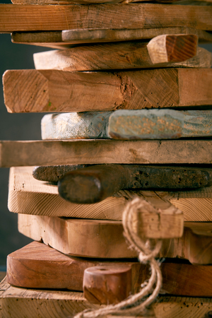 Still life with stack of wooden cutting boards in close up