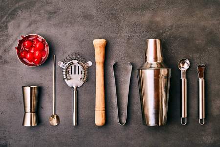 Set of Cocktail Bar utensils and vessels with bowl of cherries Stock Photo