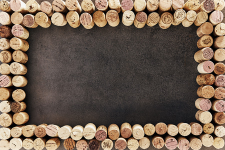 Wine corks arranged in rectangular frame against dark background