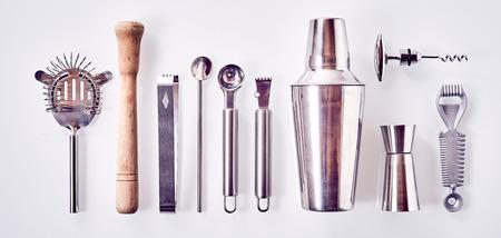 stirrer: Set of Cocktail Bar utensils arranged against white background