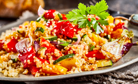 Tomato, onion, parsley mixed with quinoa served on plate
