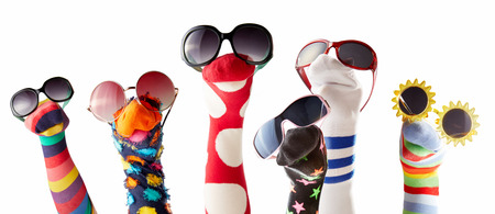 Colorful sock puppets with glasses isolated against white background