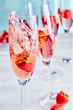 Fresh strawberries in pink champagne in an elegant flute for a special celebration or romantic occasion