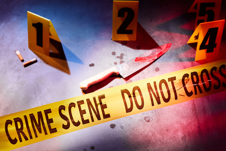 Bloody knife and bloodstains marked with evidence markers behind do not cross tape at crime scene Stock Photo