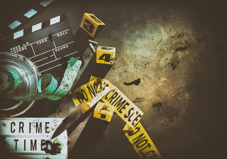 Circular film container and dirty metal knife next to yellow crime scene tape over brightly lit ground with shaded edges