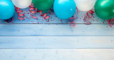Party concept of balloons, ribbons with confetti against wooden background 版權商用圖片 - 86801300