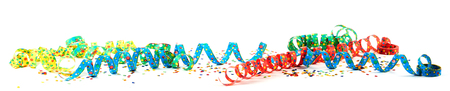 Colorful carnival ribbons with confetti against white background Foto de archivo
