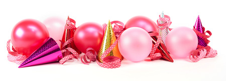 fasching: Carnival theme of colourful party hats with balloons and ribbons against white background