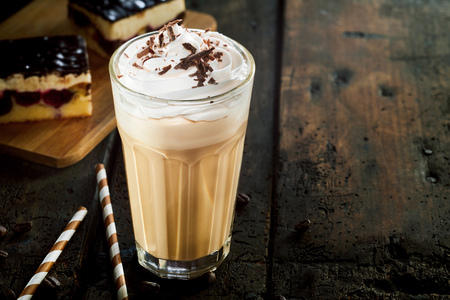 Glass of frappe coffee with cream and chocolate sprinkles on table Stock Photo