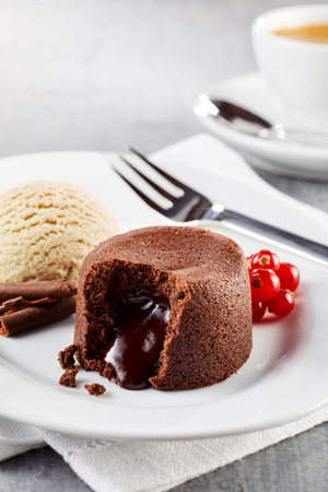 Chocolate lava cake with ice cream served on plate in close up view