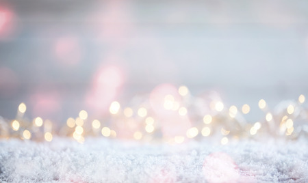 Ethereal soft Christmas background with a magical sparkling bokeh of party lights in a misty dreamy background over snow with copy space Foto de archivo
