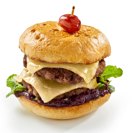 Double decker or whopper Venison burger with melted cheese and wine sauce on a crusty bun isolated on white Stock Photo
