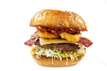 Isolated surf and turf burger with seafood and meat on a toasted bun with cheese, calamari, beef patty and crispy bacon