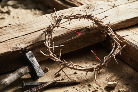 Crown of thorns among cross, hammer with nails as crucifixion symbols
