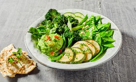 Buddha bowl full of tasty green vegetables with avocado dip Stok Fotoğraf