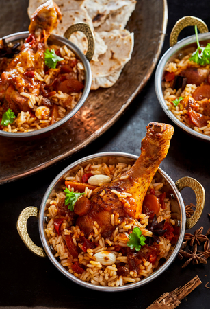 Arabian regional cuisine with a bowl of kabsa or long grained basmati rice served with meat, vegetables and spicy seasoning
