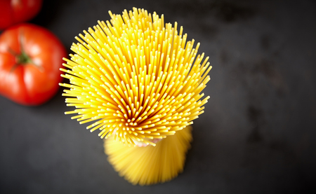 Bunch of raw spaghetti in close up high angle view