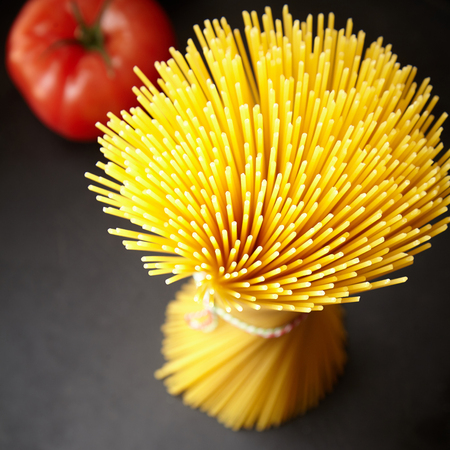 Bunch of raw spaghetti in high angle close up view