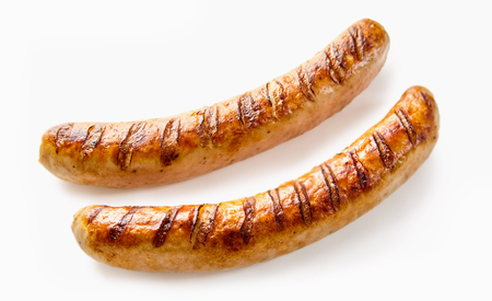 Studio shot close-up of two grilled German sausages on white background for copy space Stockfoto