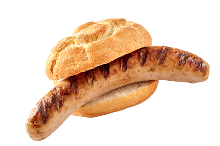 A seared barbecued sausage in a crusty bread roll with a white background and copy space. Standard-Bild