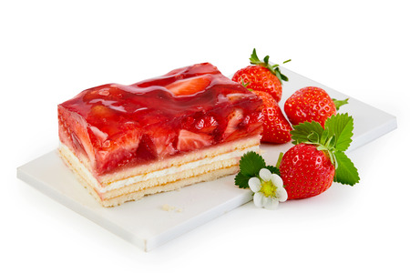 Delicious freshly baked layer cake topped with strawberries served on a white board with fresh whole fruit isolated on white Imagens - 102591294