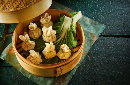 Traditional Asian dim sum dumplings in bamboo basket