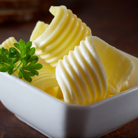 Butter curls for restaurant advertising in a bowl cold and fresh.