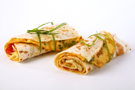 Tasty fresh African rolex rolls street food with omelette wrapped in chapati flatbread