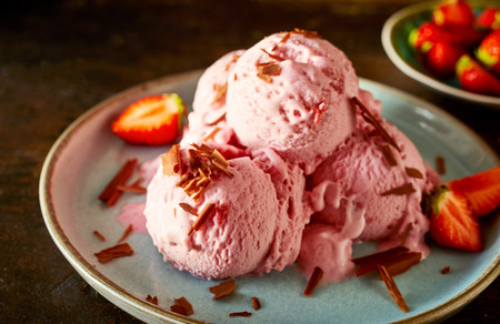 Strawberry ice cream dessert with sprinkled with chocolate