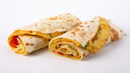 Fresh African rolex roll takeaway wraps with omelette, vegetables Stock Photo