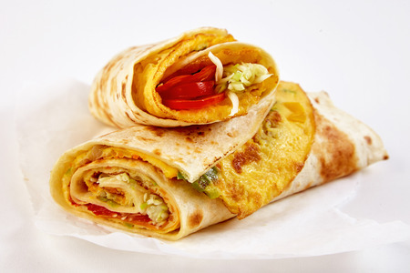 Fresh tasty African rolex rolls with omelette wrapped in chapati flatbread in close up