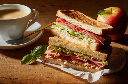 Fresh tasty double sandwich with cup of coffee and apple for lunch Stock Photo
