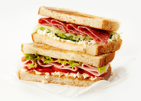 Fresh tasty breakfast sandwich with ham, lettuce, tomatoes in close up Stock Photo
