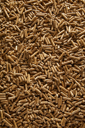 Full frame background texture of wood pellets made from compressed sawdust produced as a by-product of milling used as an eco-friendly renewable fuel Stockfoto - 107768395