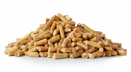 Close up on a pile of compressed wood pellets for use as an eco-friendly renewable organic biofuel or mulch in the garden over a white background Foto de archivo