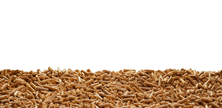 Wood chip border against a white background with copy space conceptual of organic sustainable biofuel and energy