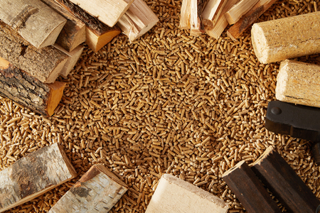 Background made up completely of mounds of wooden pegs and chopped timber logs. Includes copy space. Standard-Bild