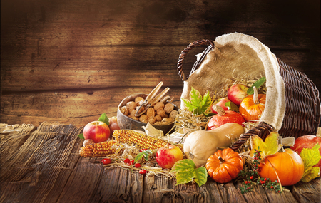 New Thanksgiving card creation for fall and autumn concepts. Rustic background with hokkaido Apples nuts and fall and autumn decorations on dark table with go to space and handwritten text . Stock Photo