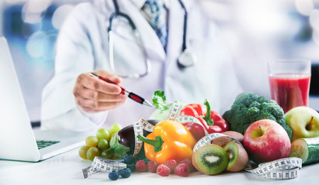 Modern doctor or pharmacy agent contact for healthy food and diet. A scene for Health concepts diet lost the plans with fresh vegetables and fruits Фото со стока