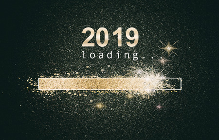 Glittering New Years background with a loading computer screen with sparkling gold bar and date over a black background Stok Fotoğraf