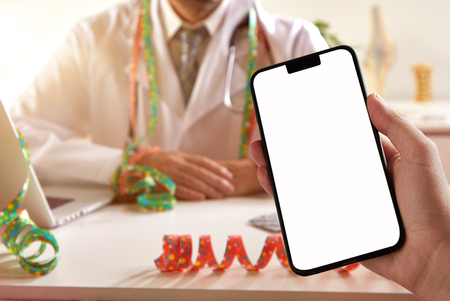 PAtient holding mobile after carnival hangover at the doctor for pharmacy advertising Stock Photo