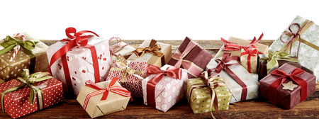 Panorama banner with Christmas gifts in colorful gift-wrapped boxes tied with bows 写真素材