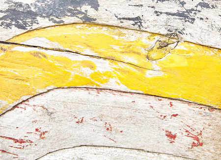 Wooden surface with peeling paint decorations, wavy carving texture and yellow paint remains. Close-up full frame artistic background concept Banco de Imagens