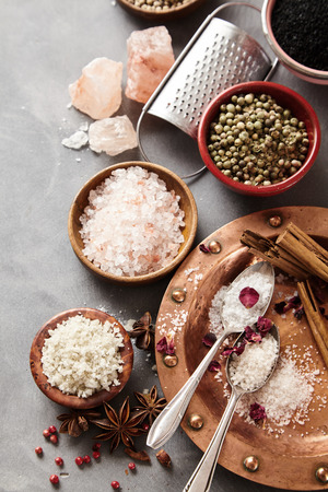 Dried spices with assorted natural culinary salts including black Hawaiian lava salt, Indus salt, Fleur de sel, Flor da Sal, Geurande salt, rock salt and sea salt viewed top down Stock fotó