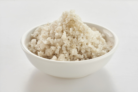 Dish of French Geurande fleur de sel, a sea salt derived from evaporation at the surface of the water and a healthy natural seasoning for food