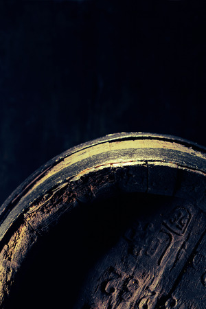 Old vintage oak barrel with imprinted lettering in the cellar of a distillery or brewery in a close up shadowy view with copy space Stock Photo