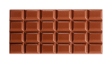 Close-up from above full-length view of an entire delicious milk chocolate tablet isolated on white for copy space Stockfoto