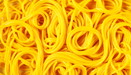 Italian spaghetti in full frame background concept. Fresh prepared curly yellow spaghetti viewed from above in close-up Zdjęcie Seryjne