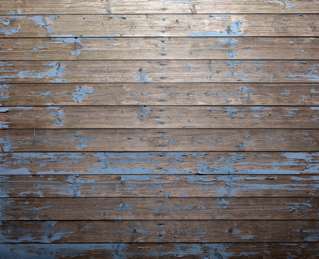 Background texture of vintage weathered natural wood boards or planks in a full frame cladding on a wall with central row of nails
